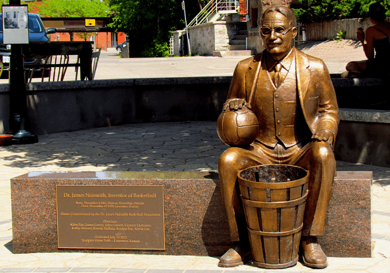 James Naismith, the inventor of basketball, also invented the first basketball hoop, using peach baskets nailed to the wall for his game.